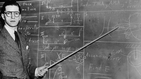 1930s Man Teacher Looking At Camera With Pointer At Blackboard